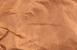 Vriden brun bästa sikt för Kraft pappers- texturerad bakgrund royaltyfri fotografi