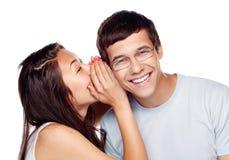 Vrienden die geheimen delen Stock Foto's