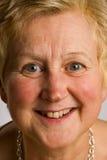 Vriendschappelijk gezicht van rijpe vrouw Royalty-vrije Stock Foto