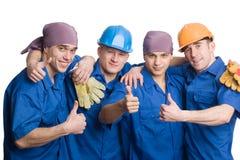 Vriendschappelijk jong team van bouwvakkers Stock Foto