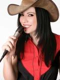 Vriendschappelijk landmeisje met een microfoon stock afbeeldingen