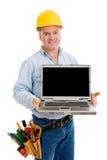 Vriendschappelijke bouwvakker & Laptop Stock Foto