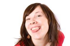 Vriendschappelijke gelukkige vrouw, die met haar zitkamer pronkt Stock Afbeelding