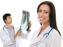 Vriendschappelijke gevende medische artsen stock foto's