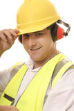 Vriendschappelijke tradesmen die zijn hoed tippen Stock Foto's