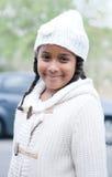Vrij Afrikaans meisje met de winterkleren Royalty-vrije Stock Foto