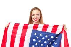Vrij blond meisje met de vlag van de V.S. stock foto's