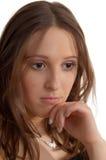 Vrij droevig meisje op wit Stock Fotografie