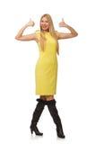 Vrij eerlijk meisje in gele die kleding op wit wordt geïsoleerd Stock Afbeeldingen