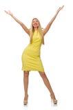 Vrij eerlijk meisje in gele die kleding op wit wordt geïsoleerd Royalty-vrije Stock Foto