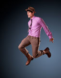 Vrij jong mannetje dat - schone studiospruit springt Stock Fotografie