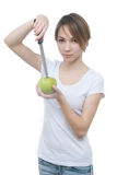 Vrij jong meisje met groen appel en mes Stock Afbeelding