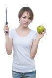 Vrij jong meisje met groen appel en mes Royalty-vrije Stock Afbeeldingen