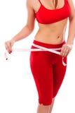 Vrij jonge vrouw die haar lichaam, gezonde levensstijlen meten concep Stock Afbeeldingen