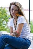 Vrij jonge vrouw met bloem royalty-vrije stock afbeeldingen