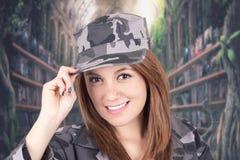 Vrij zeker trots meisje in militaire eenvormig Stock Fotografie