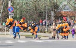 Vrijwilligers met ballons Royalty-vrije Stock Fotografie