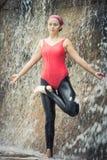 Vriksasana. Woman practicing yoga near waterfall. Tree Pose. Vriksasana Royalty Free Stock Photos