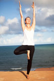 Vrikshasana yoga exercise Stock Image