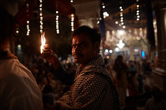 Vrindavan, 22 October 2016: A group of people offering fire at t stock photos