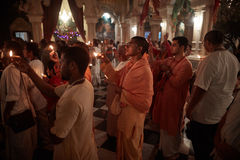 Vrindavan, 22 October 2016: A group of people offering fire at t stock image