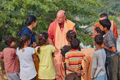Vrindavan, 22 October 2016: Hare Krishna monk surrounded by Indi. An children, in Vrindavan, UP royalty free stock image