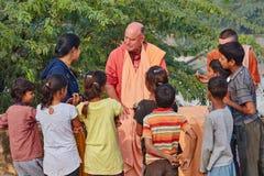 Vrindavan, 22 October 2016: Hare Krishna monk surrounded by Indian children, in Vrindavan, UP royalty free stock image