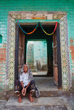 Vrindavan, 22 October 2016: Indian elderly woman sitting on the stock photography