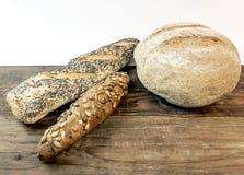 Vário pão dietético de cozimento no beckground branco Fotos de Stock