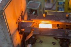Värma stål vid pannan för induktionsuppvärmning Fotografering för Bildbyråer