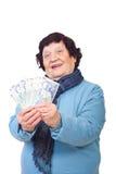 Vrolijk bejaard holdingsgeld Royalty-vrije Stock Afbeelding