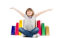 Vrolijk en blij het winkelen jong geitje Stock Foto's