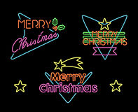 Vrolijk het neonlichtteken van het Kerstmis uitstekend vastgesteld etiket Royalty-vrije Stock Foto