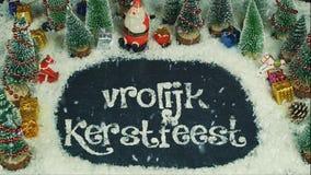 Vrolijk Kerstfeest荷兰语的停止运动动画,用英语圣诞快乐 库存照片