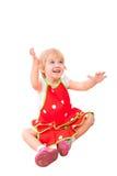 Vrolijk meisje in rode schort stock afbeelding