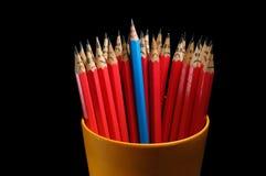 Vrolijk potlood onder droevig stock afbeeldingen