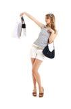Vrolijke blond met het winkelen zakken stock fotografie