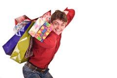 Vrolijke grappige gelukkige winkelende mens. Royalty-vrije Stock Afbeelding