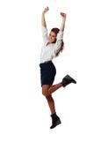Vrolijke jonge onderneemster die met omhoog wapens springen Royalty-vrije Stock Foto's