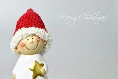 Vrolijke Kerstkaart met leuk Kerstmiself Stock Foto's