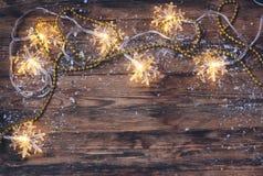 Vrolijke Kerstmis, de gelukkige nieuwe kaart van de jaargelukwens, slinger lig Royalty-vrije Stock Foto