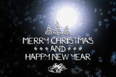 Vrolijke Kerstmis en de nieuwe kaart van de jaargroet Stock Foto's