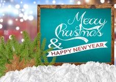 Vrolijke Kerstmis en Gelukkig Nieuwjaar op blauw bord met blurr Royalty-vrije Stock Foto
