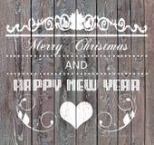 Vrolijke Kerstmis en Gelukkig Nieuwjaar op houten raad Royalty-vrije Stock Afbeelding