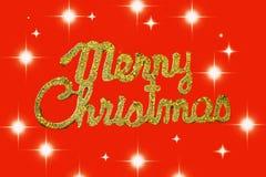 Vrolijke Kerstmis gouden tekst op een rode achtergrond met sterren royalty-vrije stock afbeeldingen
