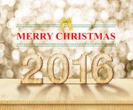 Vrolijke Kerstmis 2016 in houten textuur in perspectiefruimte met SP Stock Afbeelding