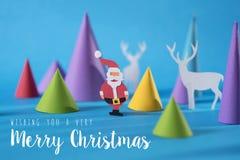 Vrolijke Kerstmis met de hand gemaakte document de hertenkaart van besnoeiingssanta Royalty-vrije Stock Afbeeldingen