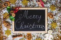 Vrolijke Kerstmis op bord Royalty-vrije Stock Afbeelding