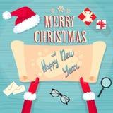 Vrolijke Kerstmis van Santa Claus Hands Scroll Old Paper Stock Afbeeldingen