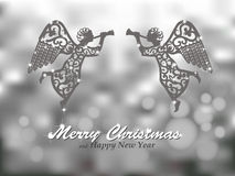 Vrolijke Kerstmis zilveren achtergrond met engelen Royalty-vrije Stock Foto
